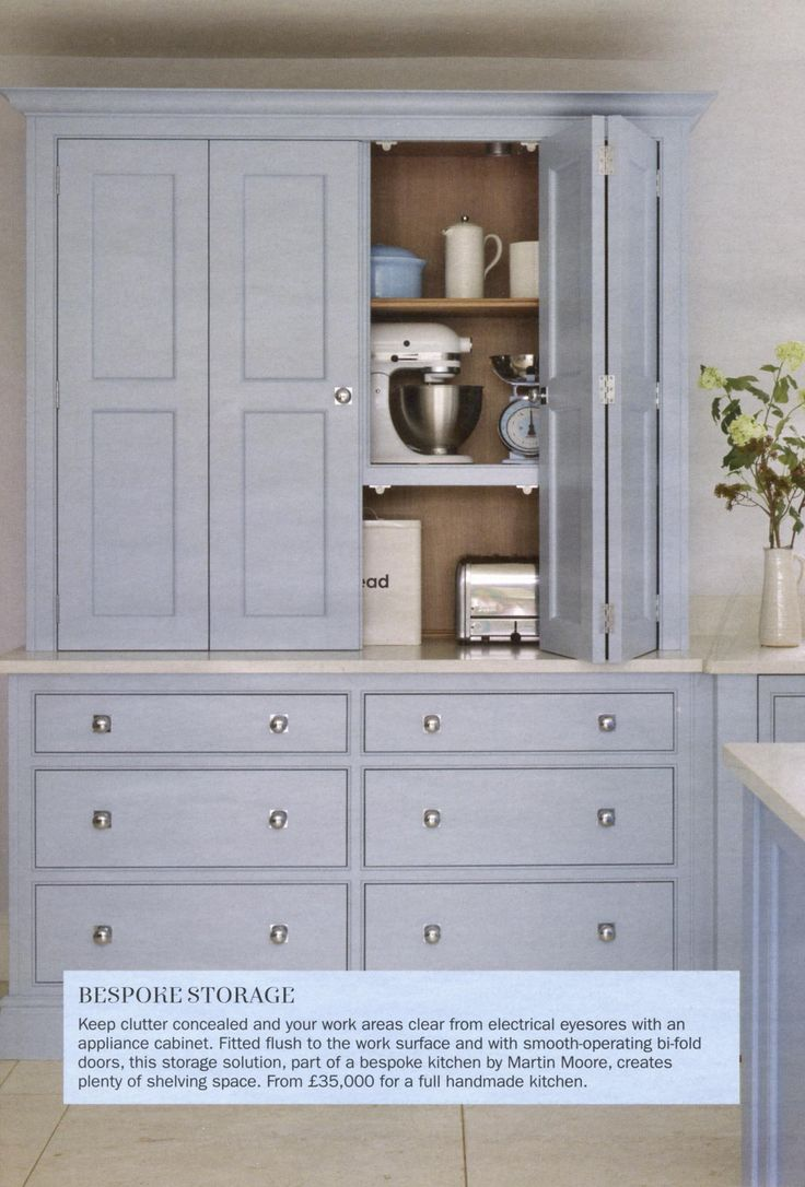 This smooth operating cupboard is part of a bespoke handmade kitchen by Martin Moore. martinmoore.com Period Living February 2018