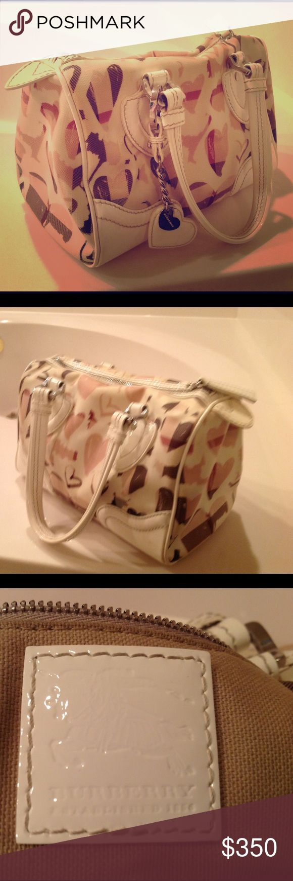 Burberry limited edition purse Very nice condition. Beautiful purse. Burberry Bags