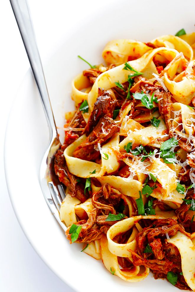 This Slow Cooker Beef Ragu is quick and easy to prep, and slow-simmered in the most AMAZING tomato sauce. Serve it over pasta, polenta, or whatever sounds good.   gimmesomeoven.com