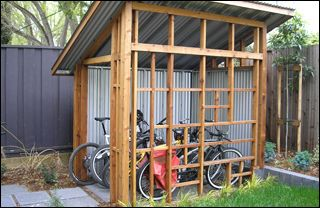 A bicycle lean-to - something like this (with half a roof) could work for the grill.