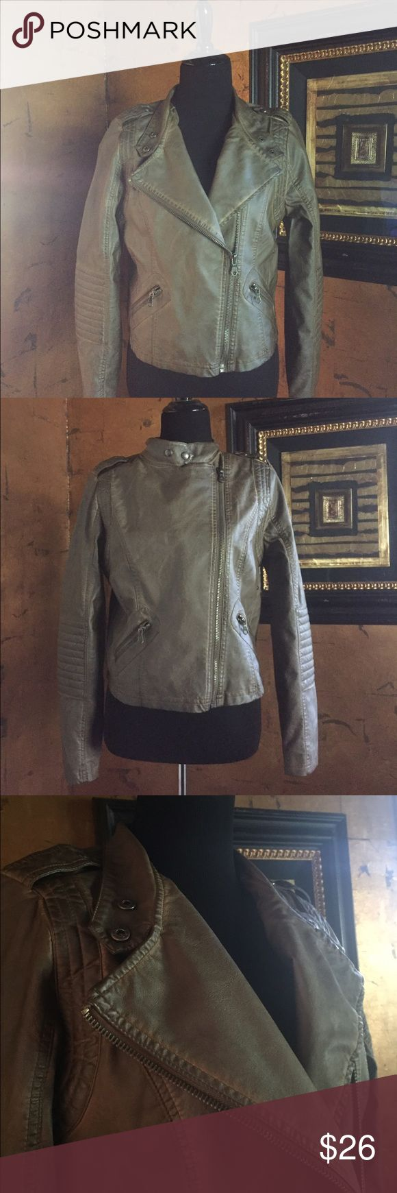 Faux Leather Bomber Jacket This brand new, never been worn, faux leather jacket with tags still attached, has impeccable style.  The jacket is designed by Black Swan. Color is a greenish tan. Front zipper than can be unzipped, partially zipped, or zipped to the top. There are 2 small zipper pockets in front and stitching on the elbows and back of the jacket which make this jacket completely out of the ordinary. Pair this jacket with jeans or throw it over a little black dress or black mini…