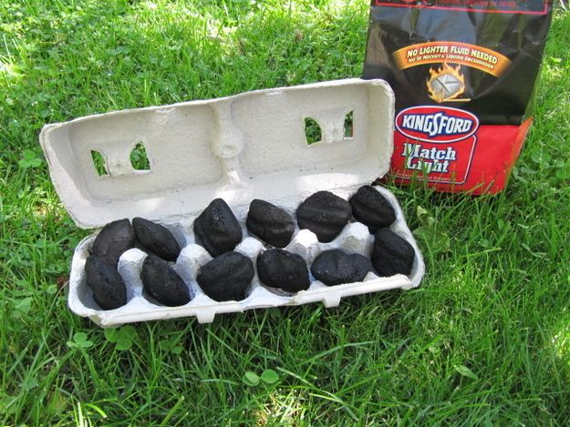 Make an easy-to-carry fire starter with a cardboard-only egg carton and match light charcoal.  Why not make it easy to start your campfire right?  Camping made easy! #camping #outdoors #campfire #hacks