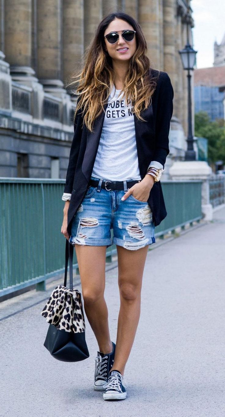 Love this whole look! Comfy tee with distressed shorts, converse sneaks and cute leopard trimmed bag.