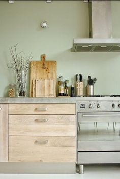 Love the color palette - mint green, grey and natural wood. Light clean and fresh.