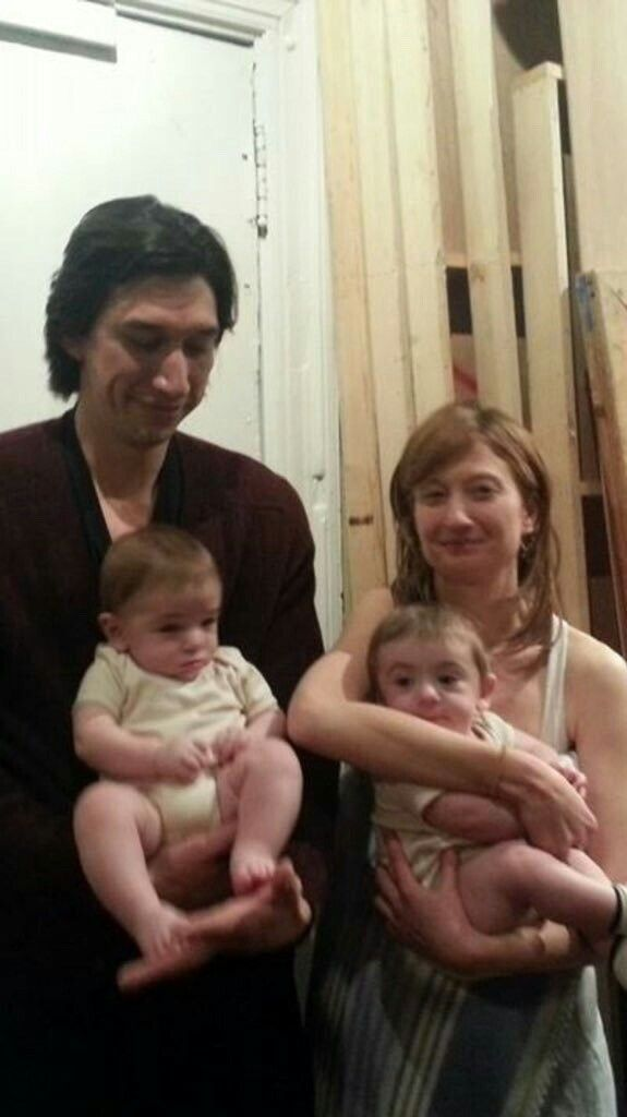 Adam Driver and co-star Alba Rohrwacher with twins who played the baby in Hungry Hearts. Adam is clean shaven with shortish hair, wearing (of course) a black jacket.