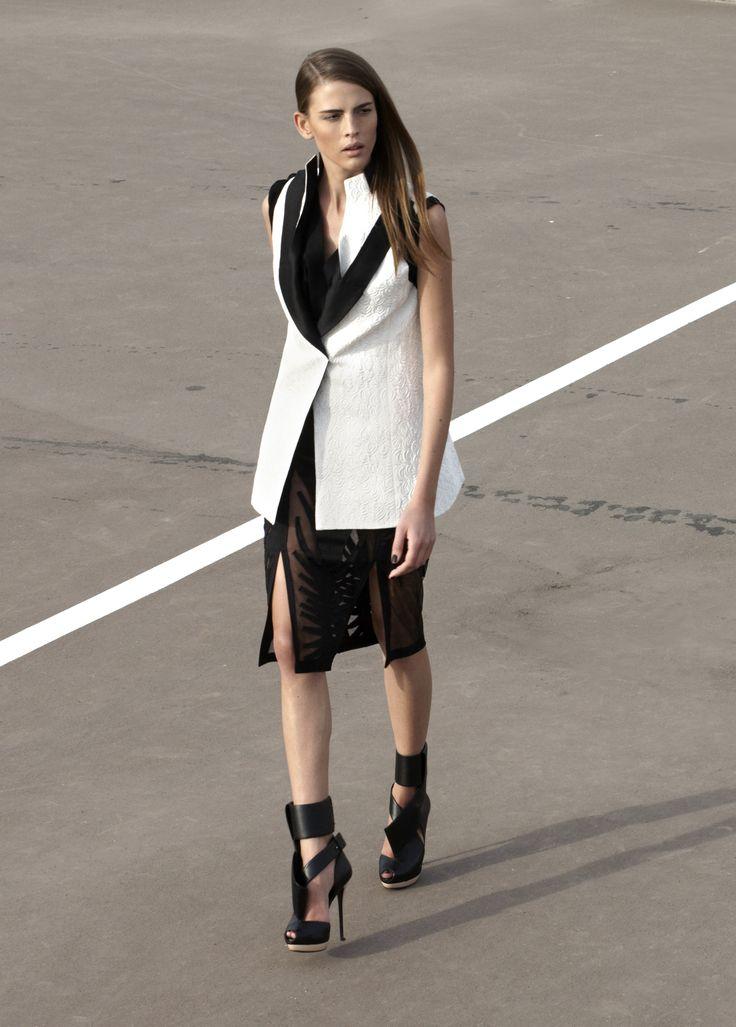 Black and white sleeveless vest