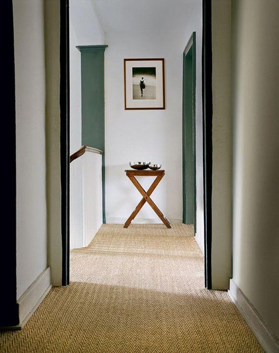 natural carpet, white walls, green woodwork