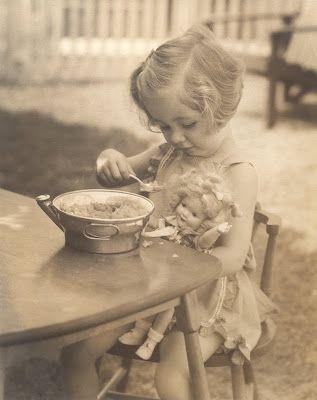 Lois Kersler feeding her doll, 1936.