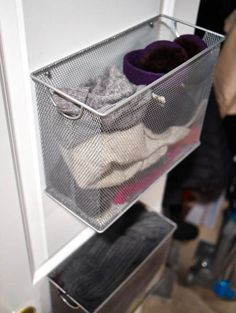 repurposed Target filing trays as winter storage, screwing them into the back of her closet door and filling them with hats and gloves.