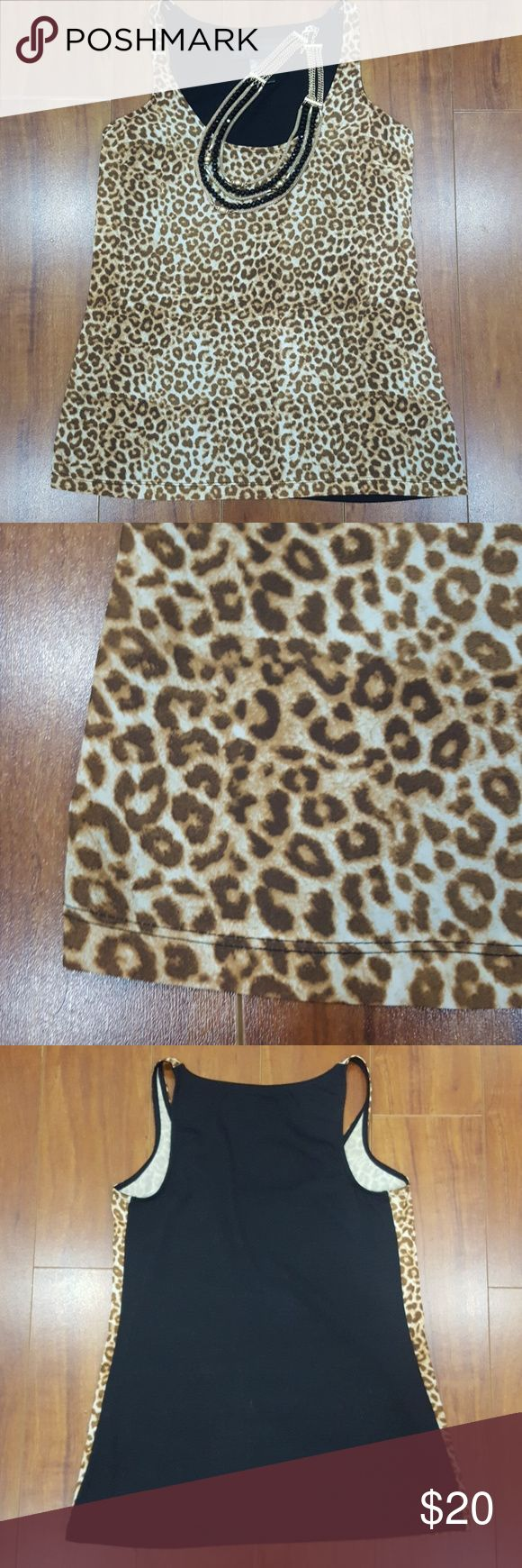 Kardashian Kollection Leopard Print Cami You have an opportunity to own this gorgeous sophisticated leopard print cami by the Kardashian Kollection.  Animal print is a staple  with the Kardashian fashion.  Leopard print on the front and semi sheer solid black at the back.  Front is 100% Polyester, back is 100% Polyester. Kardashian Kollection Tops Camisoles