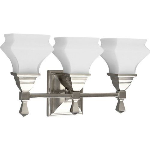 Progress Lighting P3297-09 3-Light Bath Fixture, Brushed Nickel by Progress Lighting. $186.12. Size: 17-7/8-Inch Width, 10-1/4-Inch Height Extends 5-7/8-Inch. Uses (3) 100-Watt medium base bulbs. Progress Lighting has over 5,000 lighting fixtures offered in our catalog, the largest single source for residential and commercial lighting. Brushed Nickel Finish. Opal etched glass. From the Manufacturer                Handsome craftsman style fixtures with a unique...