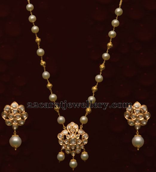 Small white south sea pearls and gold small round beads alternate combination light weight long chain  merged with very simple floral pat...