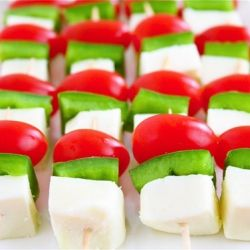 Christmas Mini-Skewers --- easiest appetizer ever!!!  Just cherry tomatoes, green peppers, and mozzarella -- oh-so-festive!  :)