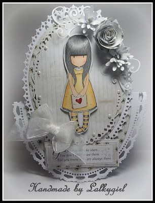 a card made using a gorjuss girl stamp and papers and nesties