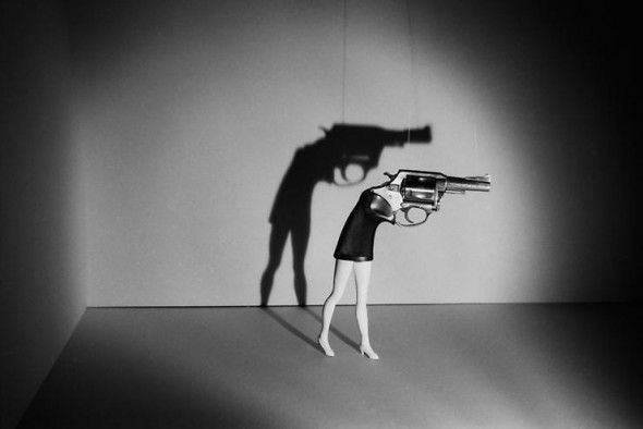 1. Walking gun| Laurie Simmons| 1998 2. The gun in this picture reminds me of hostility and danger. I feel like it is about hiding your feelings until you explode. Especially for women, it's easy to feel like you have to be perfect all the time, and this woman may have had it up to her breaking point.