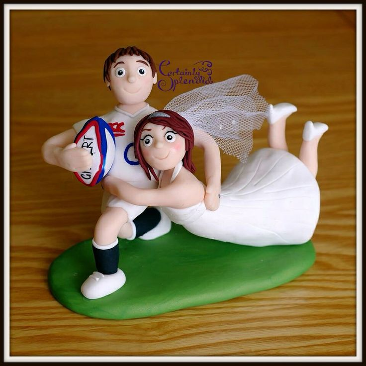 Personalised funky rugby tackle wedding cake topper complete with sparkling veil! Handmade with lots of love from fimo polymer clay, so in love with this little bride and groom! Xxx