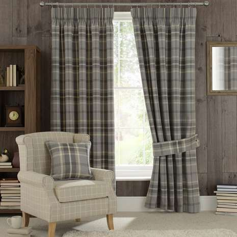 Patterned with a tartan style design in a black, grey and white colourway, these pencil pleat curtains are fully lined to help regulate room temperature and are...