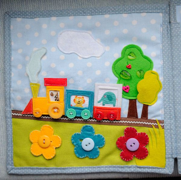 Train velcros on. Flowers button on. Bug hides under felt tree flap