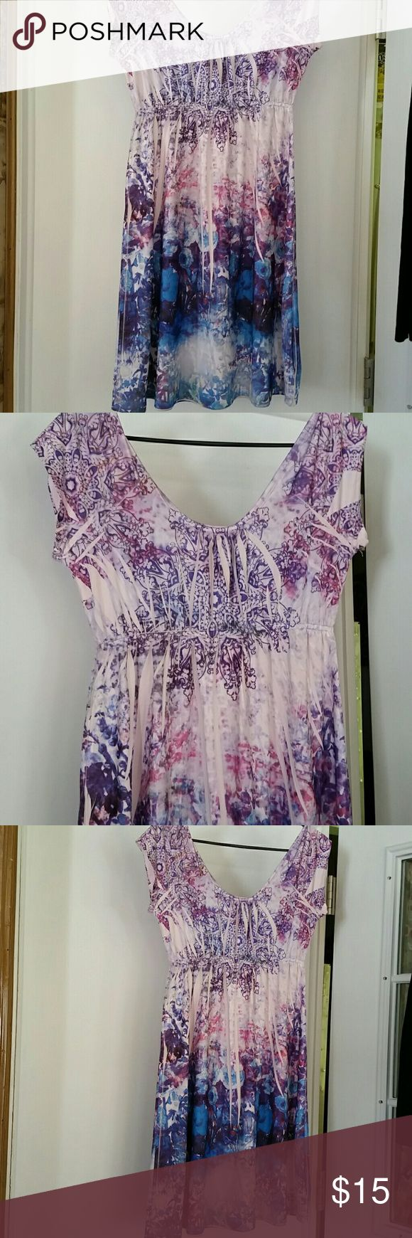 Tattoo sundress Nwot. This is a cute little floral tattoo design sundress. Brand NEW! It's a poly/spandex blend and is silky and flowy! Beautiful shades of purple and blue. From non smoking and pet free home. Price negotiable! Kiara Dresses
