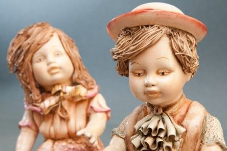 Statuettes of Children at play in Capodimonte porcelain finely carved and decorated with bow hats noodle style. www.apoggi.com     Price is intended for single unit. When purchasing, please indicate in the text field located at the bottom of the order page, which keys you are interested in (Francis or Margarat).      Dimensions cm. 20x16