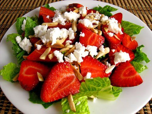 Strawberry & Feta Salad  1 clove garlic (grated)1/2 teaspoon honey1/2 teaspoon Dijon mustard1/2 tablespoon raspberry vinegar1/2 tablespoon balsamic vinegar1 tablespoon olive oil1 serving romaine lettuce (cut into bite sized pieces)1 handful strawberries (sliced)1 handful feta cheese (crumbled)1 handful slivered almonds (toasted)Directions:1. Mix the garlic, honey, mustard, vinegar and oil.2. Toss the lettuce, almonds, strawberries and almonds with the dressing to coat.