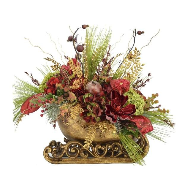 Add everlasting abundance to your decor with the Holiday Gathering Sleigh Floral Arrangement. The beautifully painted resin sleigh is lush with festively colored berry picks, cactus branch, green pine, hydrangeas, magnolias, iced berry picks and apple branches. Artistically arranged silk/polyester florals Designed for indoor use Housed in a decorative resin sleigh