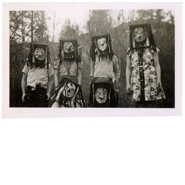 """""""From Ossian Brown's exquisite collection of antique vernacular photographs of Halloweens past. Brown compiled his favorites of the freaky found photos, all dating between 1875 and 1955, into a lovely new book titled Haunted Air. David Lynch wrote the introduction."""" ... Click the picture to open the link, then look at the gallery. Kids *really* knew how to be scary back then."""