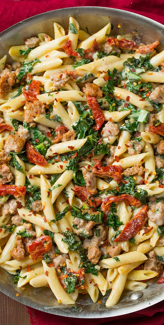 Creamy Kale and Turkey Sausage Pasta with Sun Dried Tomatoes - this pasta is seriously DELICIOUS!! I love that it's made with a lighter cream sauce and turkey sausage so you don't have to feel guilty about it.