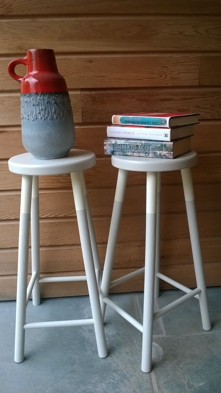 Two very tired pine stools, re-loved and very on trend. They have been given a coat of Dolphin Eggshell Chalk Paint by Autentico and a cool stripe in Paris White Versante. Perfect for all interiors.  http://www.facebook.com/featherandgray
