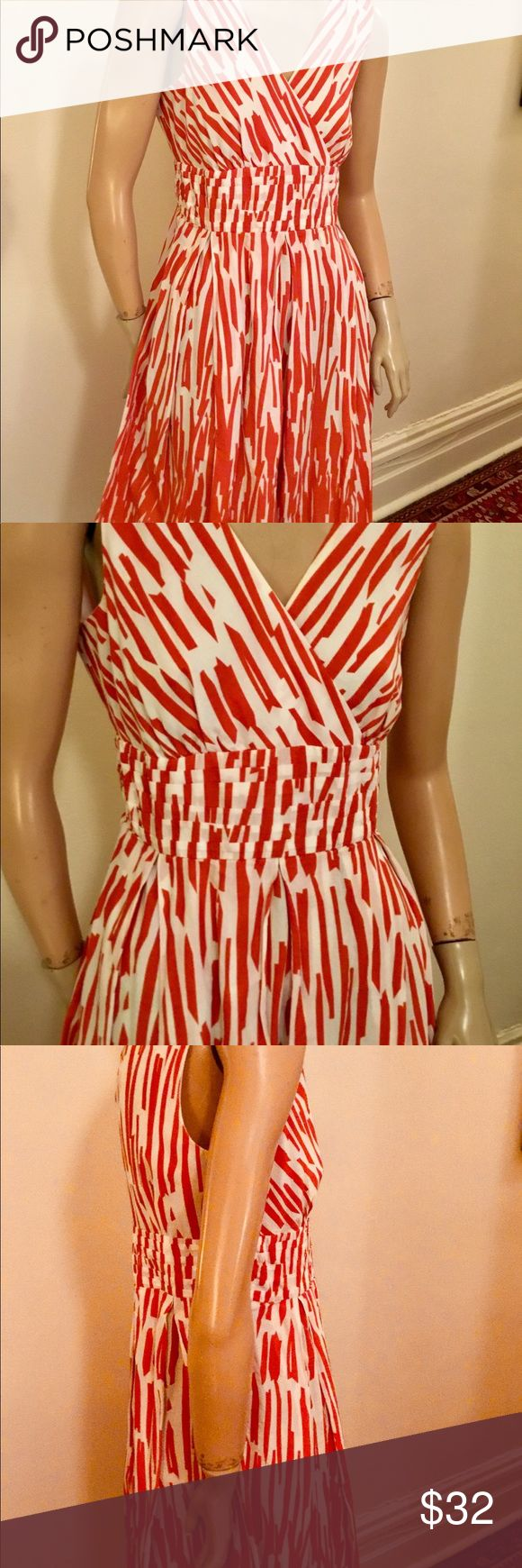 Red and white Summer day dress This is a comfortable poly blend day dress for warm weather that is sleeveless with a crossover v line neckline, empire bodice and a pleated cummerbund waist.  The skirt has inverted pleats and is knee length. It is size 8 or check the measurements below. Vintage Dresses Midi