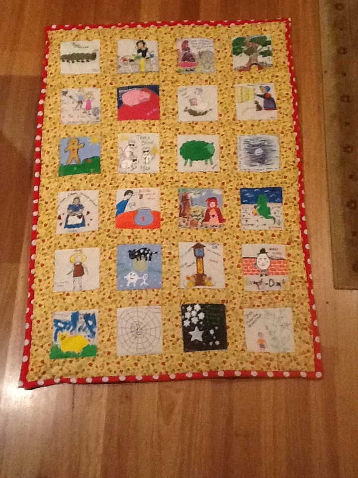 The guests all painted a nursery rhyme square or favorite childhood book which I have just completed turning into an heirloom quilt full of happy memories provided by Skye's friends and family.  Looking forward to the owner of the quilt's safe arrival sometime this week!