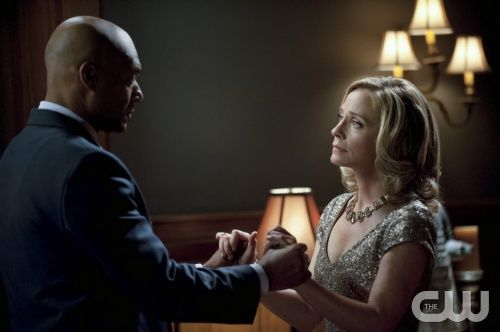 "Arrow -- ""Year's End"" -- Image AR109b_0239b -- Pictured (L-R): Colin Salmon as Walter and Susanna Thompson as Moira -- Photo: Cate Cameron/The CW -- ©2012 The CW Network. All Rights Reserved"
