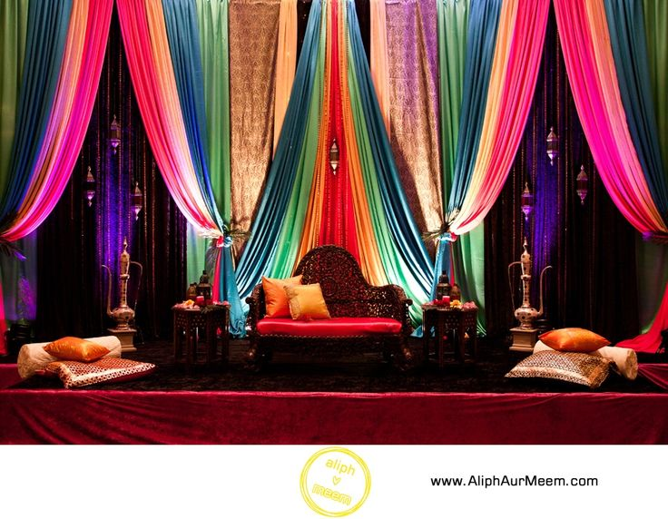Mehndi Decoration Hall : Multicolor backdrop for sangeet party stage decor