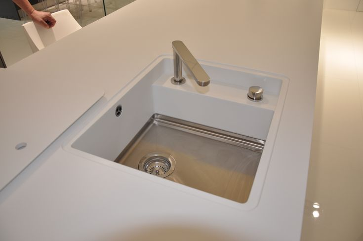 Corian Mixa Sink with custom tap area and flush cover.