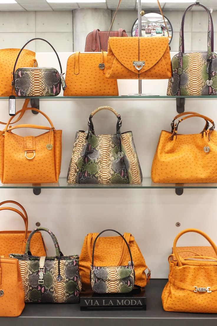 handbags on display at the Via La Moda Showroom. Note the 2134 - WOW handbag in handprinted python centre piece