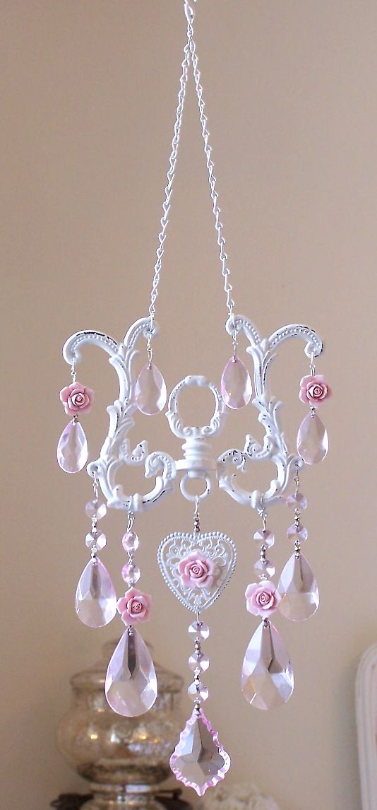 DIY: Sun catcher made from chandelier parts and porcelain roses.
