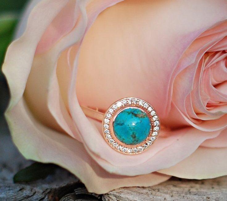 Turquoise & diamond halo engagement ring sent on rose gold.
