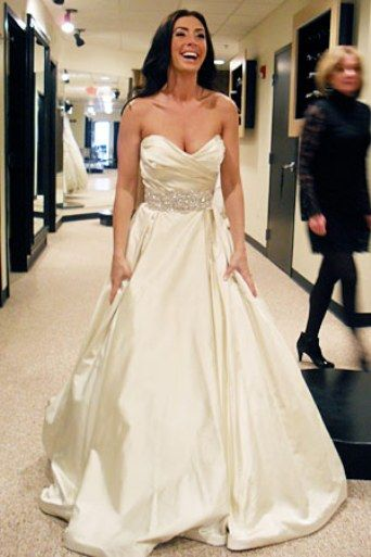 This doesn't look like my dress but the shape and color is very similar and it's the same designer: Lazaro. I still can't believe I own a wedding dress.