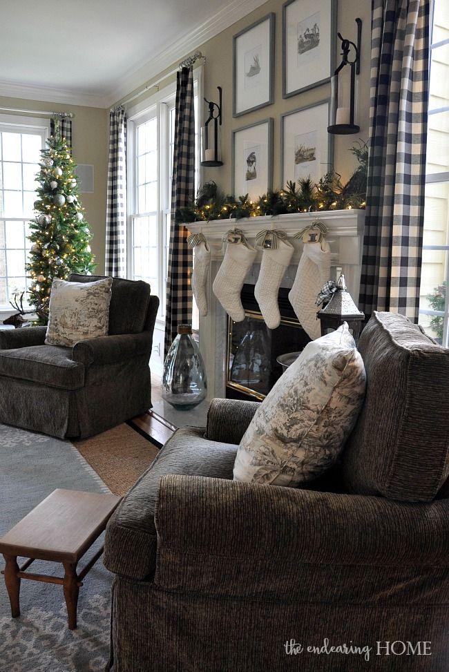 Pottery Barn Lanterns hanging above fireplace.   Christmas in the Family Room 2015 - The Endearing Home
