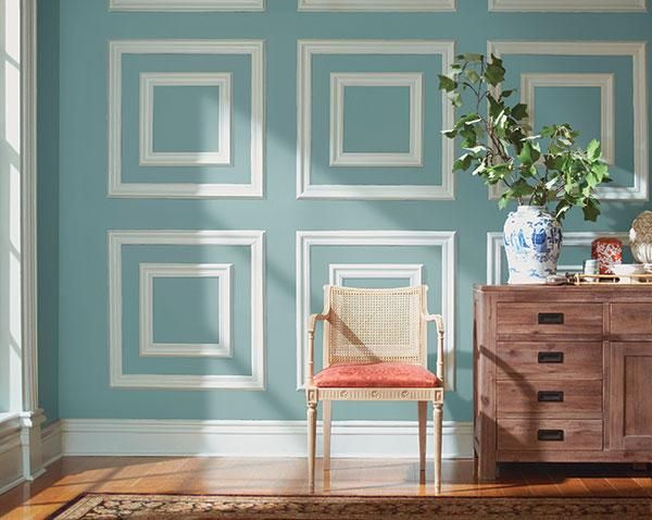Create patterns with moulding and paint to add a graphic touch to a room.