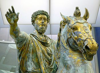 Empire: Equestrian Sculpture of Marcus Aurelius, bronze, c. 173-76 C.E., (Capitoline Museums, Rome). The original location of the sculpture is unknown though it had been housed in the Lateran Palace since the 8th century until it was placed in the center of the Piazza del Campidoglio by Michelangelo in 1538. The original is now indoors for purposes of conservation. Marcus Aurelius ruled 161-180 C.E.