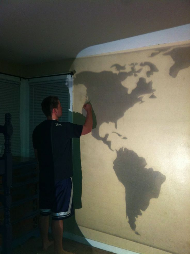 So, after much debating with myself, I decided to swap bedrooms with my kids. My bedroom was downstairs and looked like this… Well, all of that got moved upstairs and we painted the room Behr Classic Taupe to match the rest of the house. Then, I remembered this world map wall mural I saw in …