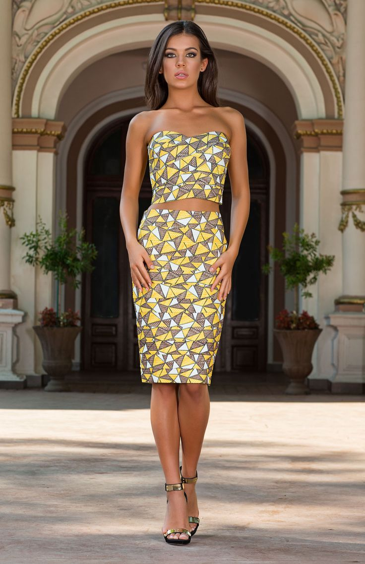 The Vespasien geometric bandeau crop top and matching pencil skirt from Vero Milano create a stunning easy-to-wear outfit day or night. http://www.veromilano.com/shop/best-sellers/dresses/vespasien-yellow/