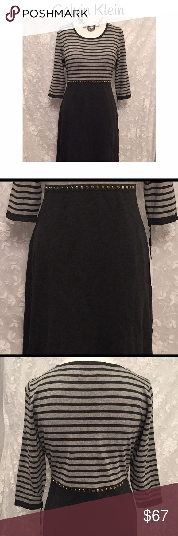 """Calvin Klein midi dress with rivets! Beautiful Calvin Klein midi dress in two tone gray with rivets around the waist. 3/4 sleeves. from the waist to the bottom measure 25"""". Fabric is 77% rayon and 23% nylon. Dry clean.(Necklace not for sale!) Calvin Klein Dresses Midi"""