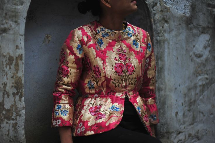 This jacket is an effortless choice. It is handmade from Beautiful hand woven gyanta fabric from Tibet. The inner Lining is made of Vintage, pure silver Thread Zari Sari.We love the contrast between structured and feminine: using unique fabric of brightly patterned brocade. One of a kind
