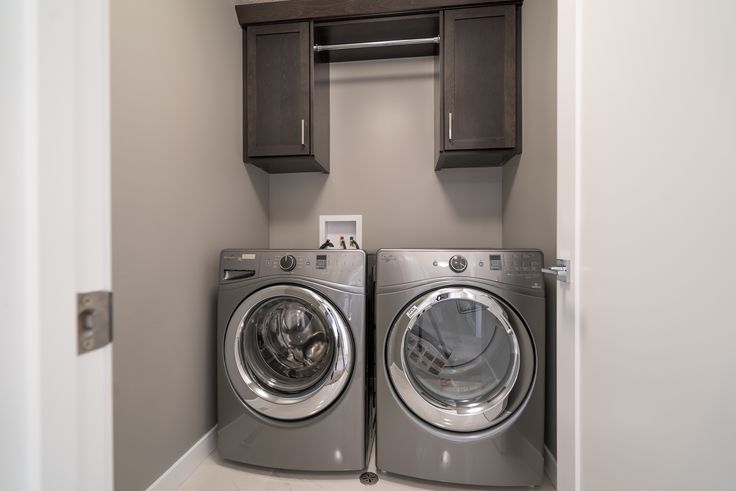 Laundry space with custom cabinets for additional storage!