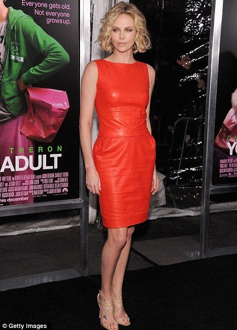 Charlize Theron (36) looks amazing in this red dress. Love the hair too