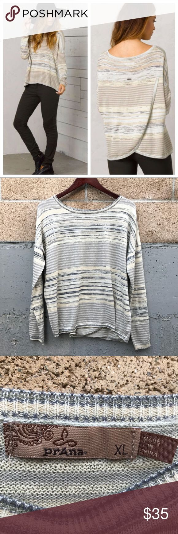 PrAna Adelaide Metallic Cross Back Sweater XL PrAna Adelaide long sleeve top, size XL. Heathered striped gray and beige in color with metallic thread woven in. Care and composition tag has been cut out but according to the manufacturer this is: 94% cotton, 4% polyester, 2% metallic. Lightweight material. Great neutral top with a twist. Cute cross back detail. EUC - no visible flaws.  shoulder to shoulder: 27 pit to pit: 25 length: 23 Prana Tops