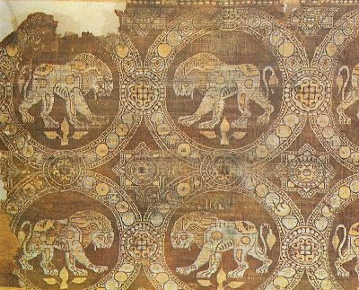 Lions. 9th - 10th Century AD: Lions. Purple silk serge. From the tomb of St. Julian in Rimini. Byzantine. Museo Naziosle, Ravenna, Spain. Volbach, Early Decorative Textiles p.139