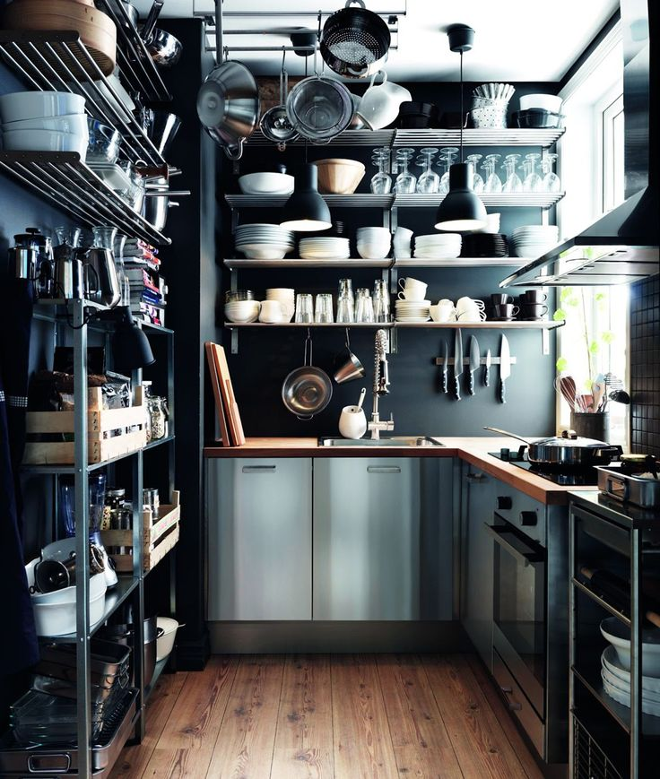 6 Swoon-Worthy Small Kitchens #refinery29  http://www.refinery29.uk/small-kitchen-ideas-interiors-tiles#slide-5  There's nothing as satisfying as a well-organised set of shelves. Ok, there are lots of things more satisfying, but this kitchen is definitely one for neat freaks who delight in having things just so. Using an array of storage methods, from hanging racks to shelves and trolleys, this industrial-style kitchen utilises every inch of space all the way up to the ceiling. On-trend…